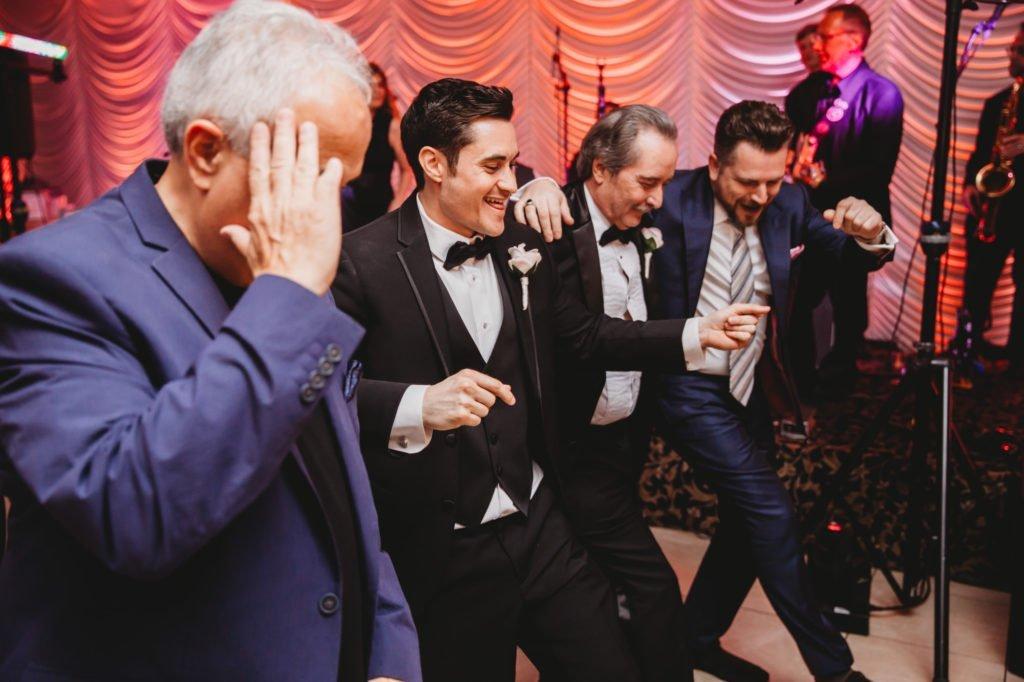groom father dancing
